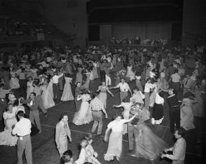 [A View of a Room of People Square Dancing]