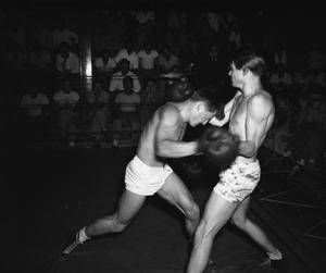 [Two Men Boxing at a Fight Night at St. Edward's University]