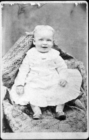Primary view of object titled '[An unidentified baby sitting up in a blanket]'.