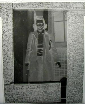Primary view of object titled '[Negative film of Mary Jones Prowell standing in front of a window]'.