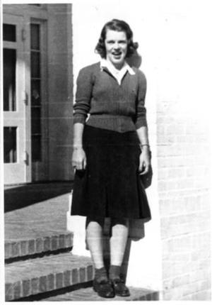 Primary view of object titled '[Mary Jones on the front steps of the Pi Beta Phi Sorority House]'.