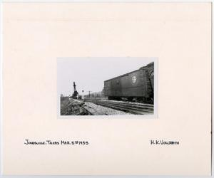 Primary view of object titled '[Train Cars Down Tracks From a Crane]'.