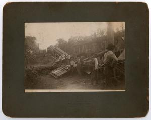 Primary view of object titled '[Men Inspecting Train Wreckage]'.