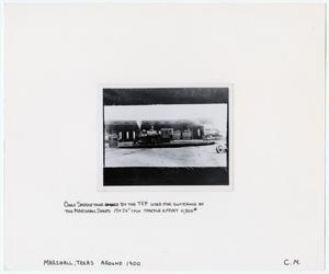 Primary view of object titled '[Train #40 in Front of a Roundhouse]'.