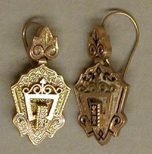 Primary view of object titled '[One gold earring in a triangular shape]'.