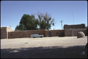 Primary view of object titled '[Street Scene at San Ildefonso Pueblo]'.