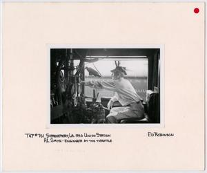 Primary view of object titled '[Engineer at the Throttle of T&P Train #701]'.
