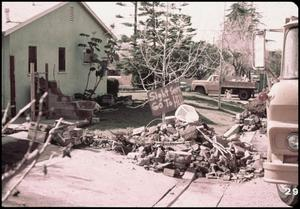 Primary view of object titled '[Damage Along the Front of the Olive View Hospital]'.
