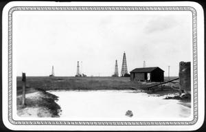 Primary view of object titled '[An area of water in front of an oil field]'.