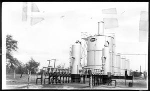 Primary view of object titled '[Photograph of oil storage tanks]'.