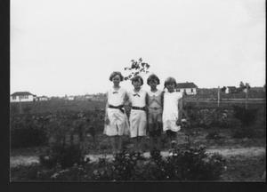 Primary view of object titled '[Four girls in the Jodarski yard]'.
