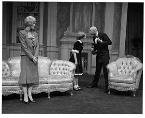 Primary view of object titled '[Annie and Daddy Warbucks Look at Each Other While Grace Farrell Watches in Annie, 1986]'.