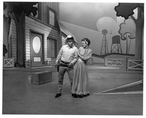 Primary view of object titled '[Actor and Actress in Oklahoma!]'.