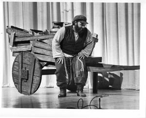 Primary view of object titled '[Jim Vaughan in Front of His Wagon in Fiddler on the Roof, 1972]'.