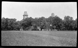 Primary view of object titled '[Photograph of Large Building Beyond Trees]'.