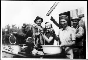 Primary view of object titled '[Albert Eben, Herbert Eben, Angie Eben, Angie Eben, and Leo Linke making sausage]'.
