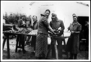 Primary view of object titled '[Members of the Linke and Eben families making sausage]'.