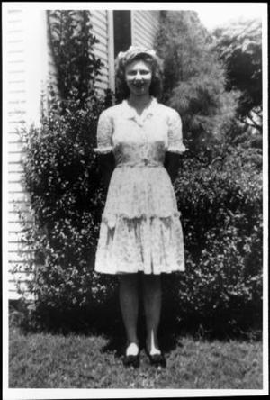 Primary view of object titled '[Bernice Linke standing outside of a house]'.