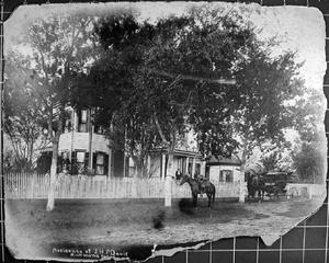 Primary view of object titled '[The J.H.P. Davis house with horses and a buggy in front]'.