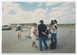 Primary view of object titled '[News Crew on an Airfield]'.