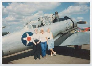 Primary view of object titled '[Women Posing with AT-6 #2]'.