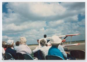 Primary view of object titled '[People by a Biplane]'.