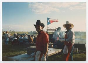 Primary view of object titled '[Two Cowboy Cooks at a Party]'.