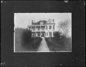 Primary view of object titled '[East exterior view of the J.H.P. Davis house]'.