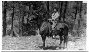 Primary view of object titled '[Loula Bunton on Horseback, 1909]'.