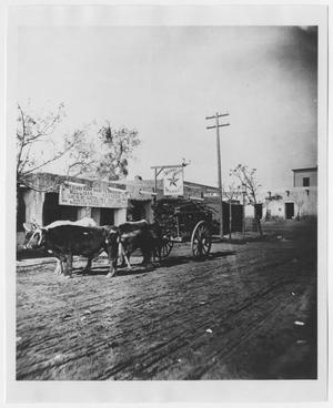 Primary view of object titled '[El Paso Street Scene with Carriage and Steer]'.