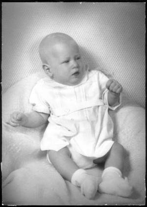 Primary view of object titled '[An infant wearing a white outfit]'.
