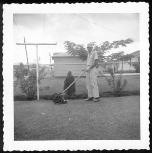 "Primary view of object titled '[A man named ""John"" mowing the yard]'."