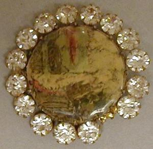 Primary view of object titled '[Circular diamond pin with a colorful image in the center]'.
