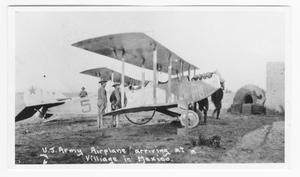 Primary view of object titled '[U. S. Army Airplane Arriving at a Village in Mexico]'.