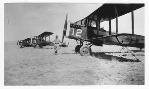 Primary view of object titled '[Man Standing Next to a Plane]'.