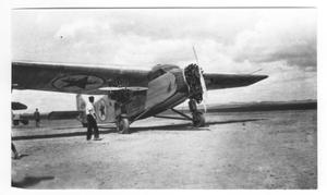 Primary view of object titled '[Man By Texaco Plane]'.