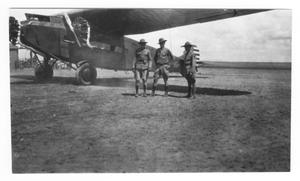 Primary view of object titled '[Three Men By Plane]'.