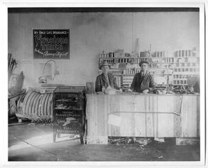 Primary view of object titled '[Two Men in Tire Store]'.