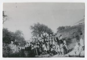 [Photograph of Church Members Standing on Creek Bank]
