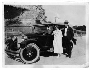 Primary view of object titled '[Couple Standing by an Automobile]'.