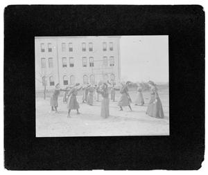 Primary view of object titled '[Girls Playing Ball at North Texas Female College]'.