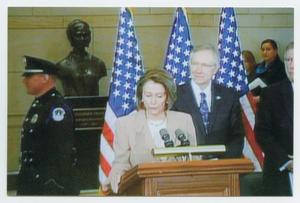 Primary view of object titled '[Photograph of Nancy Pelosi Speaking at a Podium With a Microphone]'.