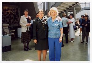 Primary view of object titled '[Servicewoman Davis posing with Teresa James]'.