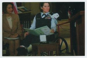 Primary view of object titled '[Lt. Col. Nicole Malachowski Speaking at a Podium #1]'.