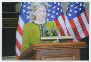 Primary view of object titled '[Kay Bailey Hutchison Speaking at a Podium]'.