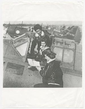 Primary view of object titled '[Three Women Talking in an Airplane Cockpit]'.
