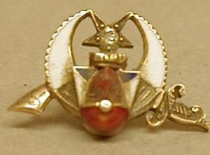 Primary view of object titled '[Masonic lodge pin with a small diamond in the middle]'.