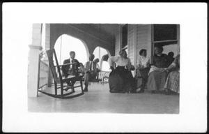 Primary view of object titled '[Postcard image of a group of people gathered on a porch]'.