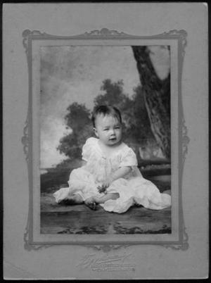 Primary view of object titled '[Virginia Hinson Ansel as an infant, wearing a white dress]'.
