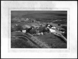 Primary view of object titled '[Aerial photograph of the George Ranch house and ranch site]'.